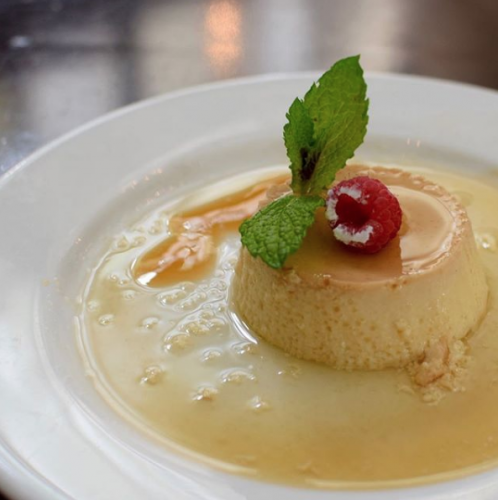 coconut flan with a raspberry on top