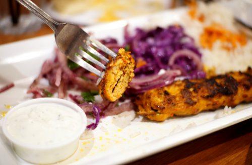 piece of chicken adana kebob on a fork