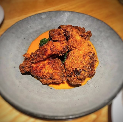 korean fried chicken wings on a gray plate