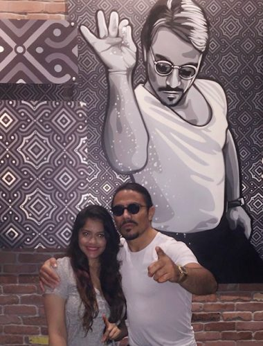 Girl standing with Nusret aka salt bae in miami